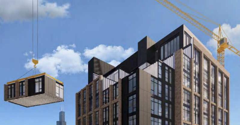 A crane putting a modular piece on a building.